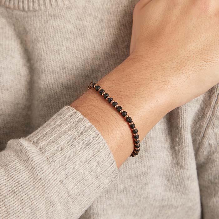 Armband aus rosévergoldetem Edelstahl und Lavastein